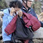 Societe actualite japon tsunami femme pleurs secours